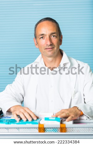 Handsome Pharmacist Portrait in a Drugstore - stock photo
