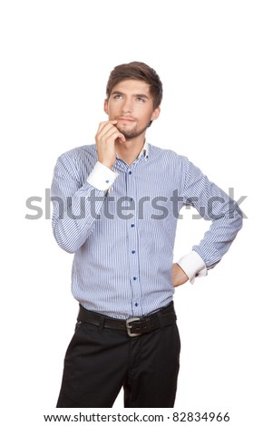 Handsome positive young business man standing and thinking, isolated over white background. Concept of idea, ask question, think up, choose, decide,