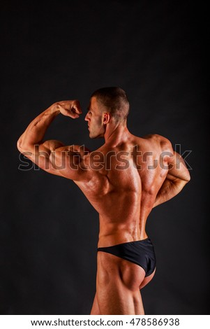 Handsome power athletic young man with great physique