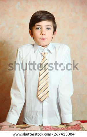 handsome preteen boy expressive portrait with white shirt and tie - stock photo
