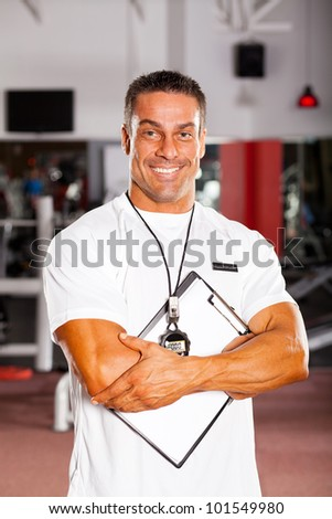 handsome professional gym instructor portrait - stock photo