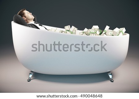 Handsome relaxing businessman lying in bathtub filled with dollar banknotes on grey background. Success concept. 3D Rendering