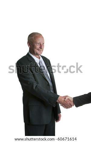 Handsome senior businessman shaking hands