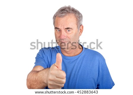 Handsome senior man in blue shirt shows thumb up.