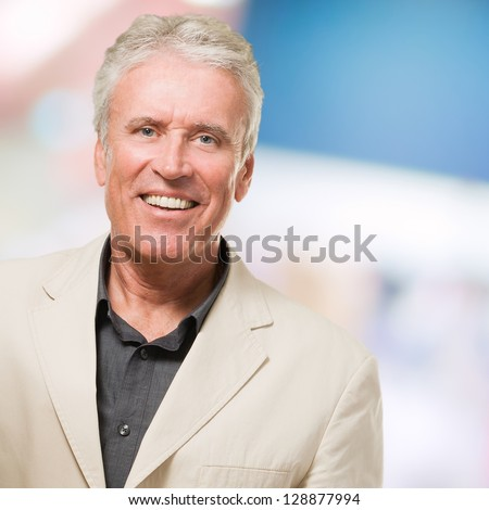 Handsome Senior Man Smiling against an abstract background - stock photo