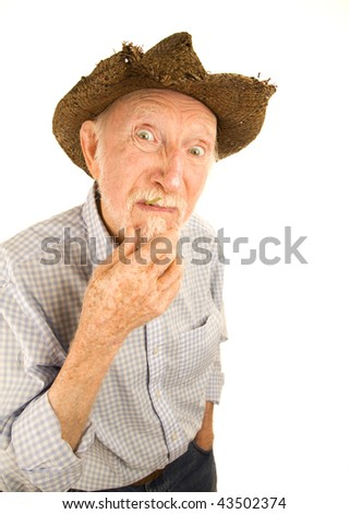 Handsome senior man wearing straw cowboy style hat