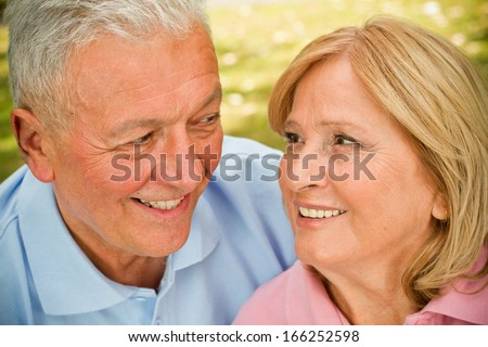 Handsome seniors in park having intimate moments