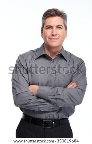 Handsome serious businessman. Isolated over white background.