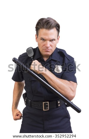 Handsome serious Caucasian police officer holding baton and charging forward aggressively on white background - stock photo