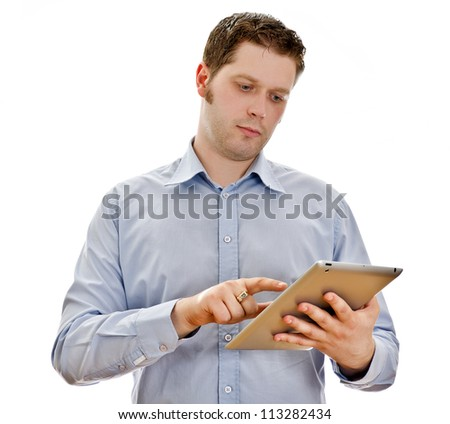 Handsome serious man with tablet computer. Isolated on white
