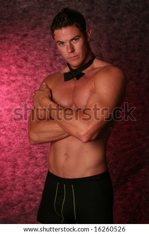 Handsome sexy male gigolo stripper Studio shot with black bow tie - stock photo