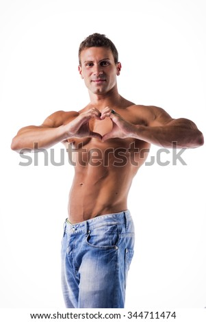 Handsome shirtless muscular young man making heart sign with his hands and fingers. Studio shot isolated