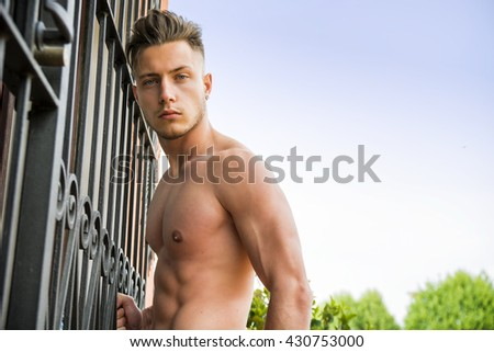 Handsome shirtless muscular young man outdoor - stock photo