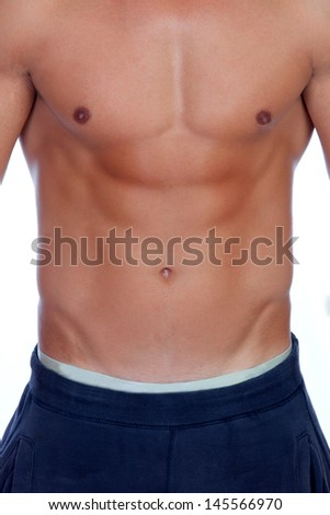 Handsome shirtless young man with defined muscles isolated on a white background - stock photo