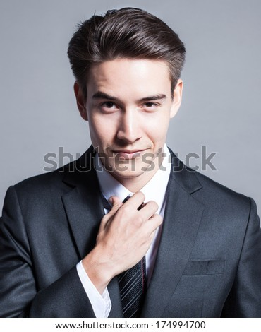 Handsome smiling business man - stock photo