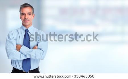 Handsome smiling businessman over blue banner background. - stock photo