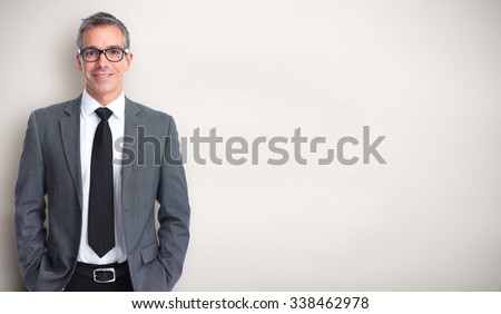 Handsome smiling businessman over gray banner background. - stock photo