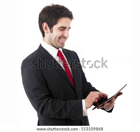 Handsome smiling businessman with tablet computer. Isolated over white background - stock photo