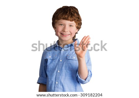 Handsome smiling caucasian boy with red hair waving with his hand. Isolated on white background - stock photo