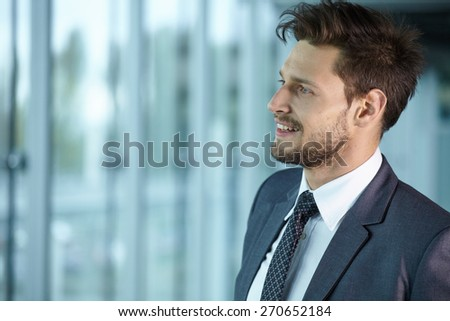 Handsome smiling confident businessman portrait - stock photo