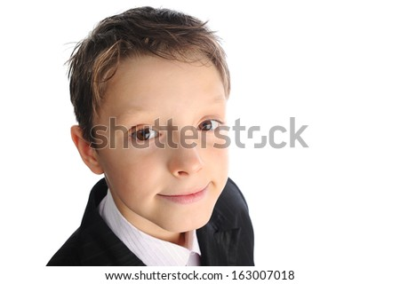 Handsome smiling curious schoolboy closeup portrait