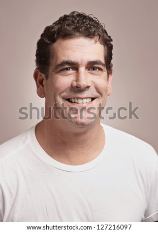 Handsome smiling man in white tee-shirt