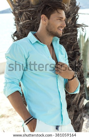 Handsome smiling man wearing shirt. Pure natural photo of natural man with perfect smile  - stock photo