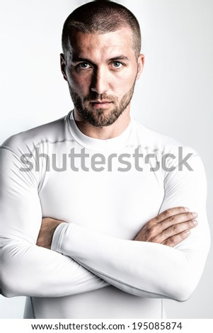 Handsome sportsman is looking serious - stock photo