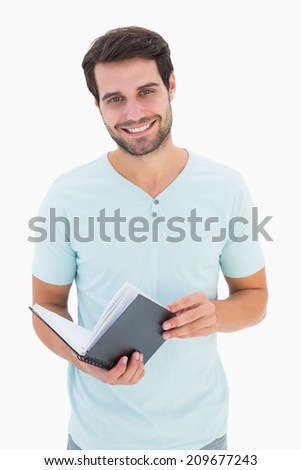 Handsome student smiling at camera on white background