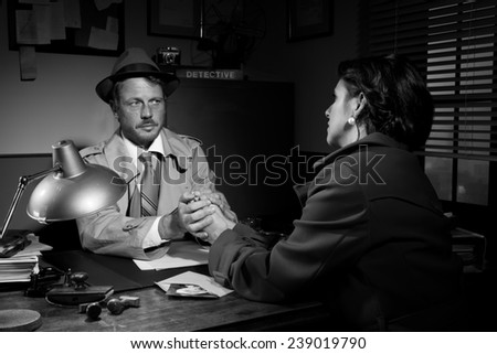 Handsome supportive detective at office desk holding a young woman's hands and comforting her, film noir.