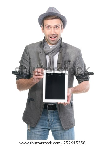 Handsome surprised man in hat with digital tablet pc. Isolated. - stock photo