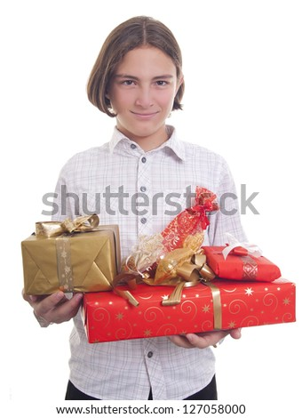 Handsome teenage boy holding bunch of presents in his hands
