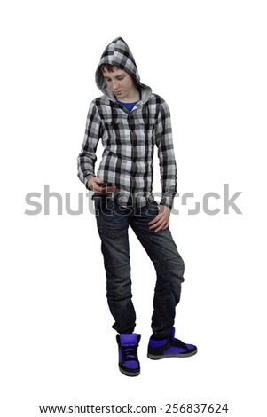 Handsome teenage boy in plaid shirt with hood looks his cell phone isolated on white background - stock photo