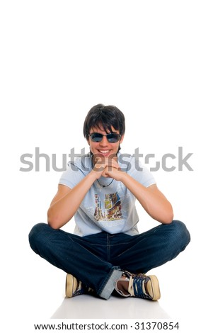 Handsome teenager boy, casual dressed, wearing sunglasses, hip hop culture.  Studio shot, white background