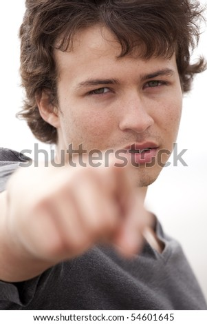 Handsome teenager pointing to you