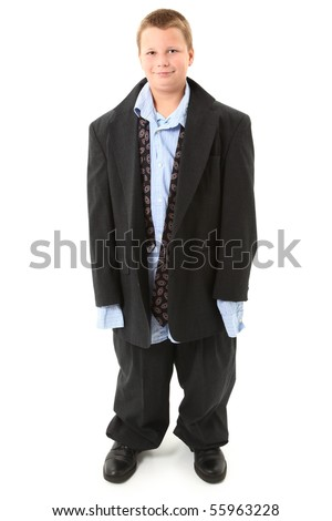 Handsome ten year old american boy in over sized suit over white.