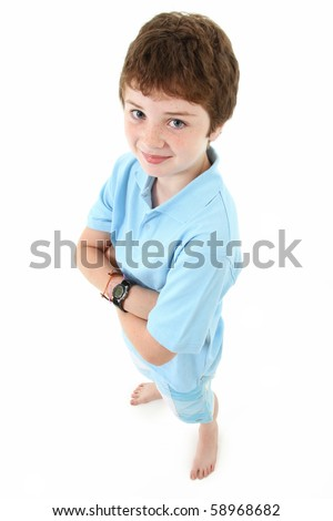 Handsome ten year old american boy standing over white background.  Top view.