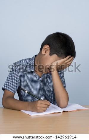 handsome toddler not interested in doing homework - stock photo