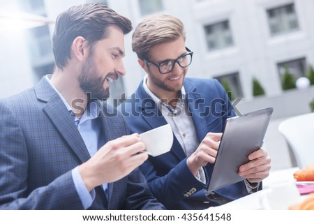 Handsome two businessmen have a meeting in cafe - stock photo