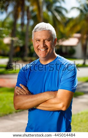 Handsome unshaven middle age man outdoor portrait.
