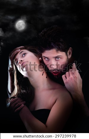 handsome vampire biting girl isolated in dark background