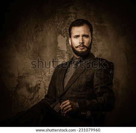 Handsome well-dressed  sitting in leather chair  - stock photo