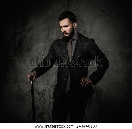Handsome well-dressed with walking stick