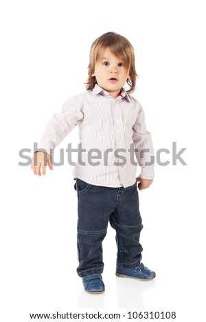Handsome 2 years old boy standing, wearing shirt and blue jeans. High resolution image isolated on white background with copy space. Studio shot