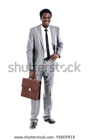 Handsome young african businessman with briefcase - stock photo