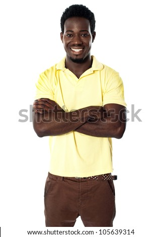 Handsome young african male posing with folded arms. Smiling at camera - stock photo