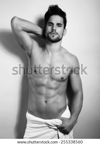 handsome young and fit bodybuilder after shower showing of his perfect body and six pack