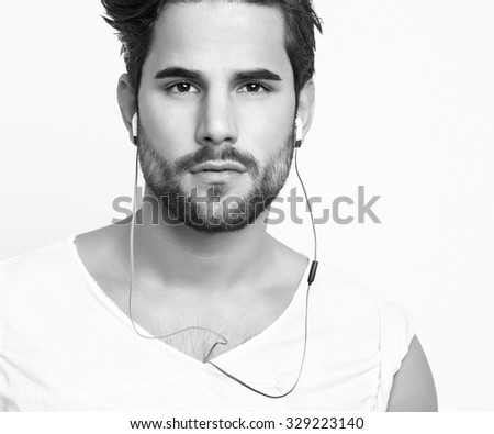handsome, young and fit man in workout clothes with earphones - stock photo