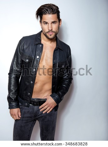 handsome young and fit man posing with open jacket