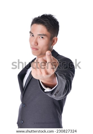 Handsome young angry business man point finger at you, businessman serious looking at camera, isolated over white background - stock photo